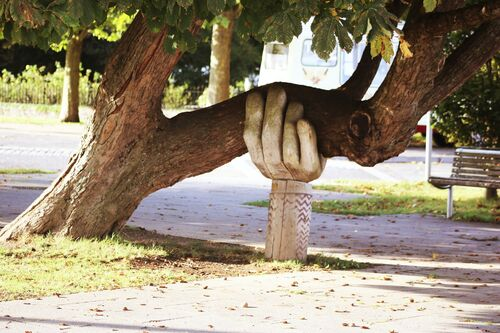 Tree with hand sculpture support